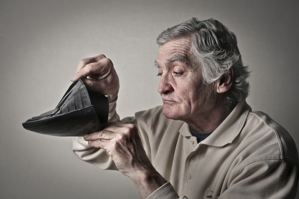 Old Man looking into an empty wallet