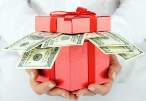 Person giving red gift stuffed with money