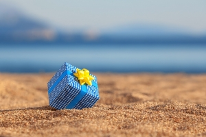 Charitable planning tax service as indicated by gift wrapped on San Diego beach
